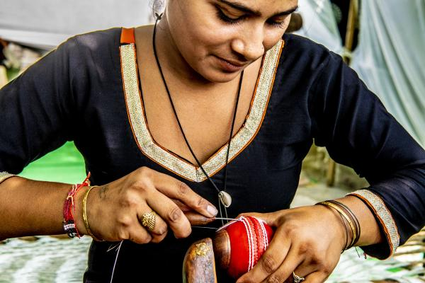 During her 2018 visit to India, the UNSGSA met entrepreneurs who make cricket balls and other sports equipment.